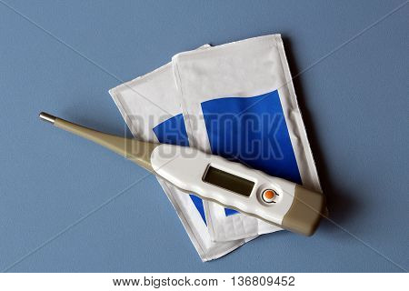 thermometer and sterile gauze two bags of drugs