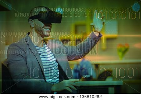 Blue technology design with binary code against male graphic designer wearing virtual glasses