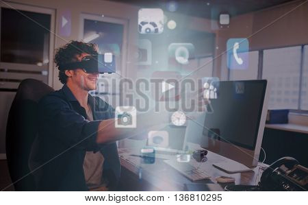 Futuristic app icons floating in light against businessman wearing virtual glasses