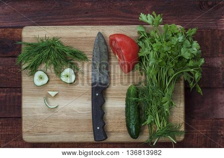 vegetables for healthy salad sliced funny face cucumber and dill