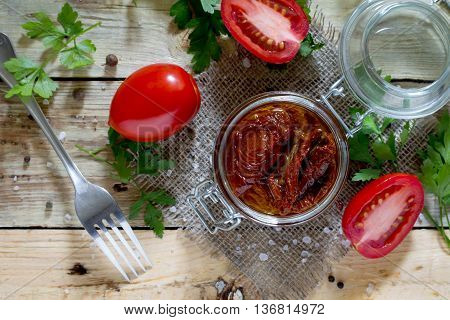 Sun-dried Tomatoes In A Jar On A Wooden Table, Top View.