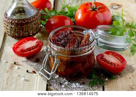 Sun Dried Tomatoes On A Wooden Table In Rustic Style