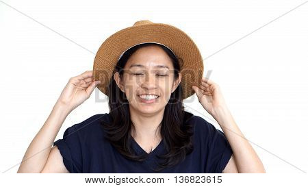 Casual Friendly Asian Girl Wearing Hat Relaxing And Smiling On Isolated Background