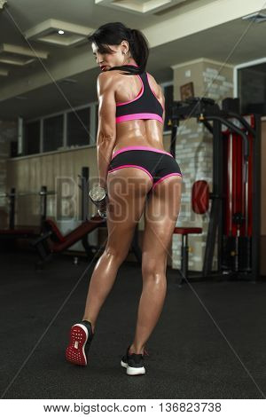 Brunette Sexy Fitness Girl In Sport Wear With Perfect Body In The Gym Posing Before Training Set