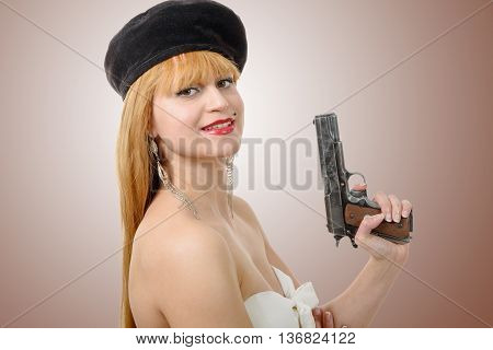 a pretty young sexy woman with a gun
