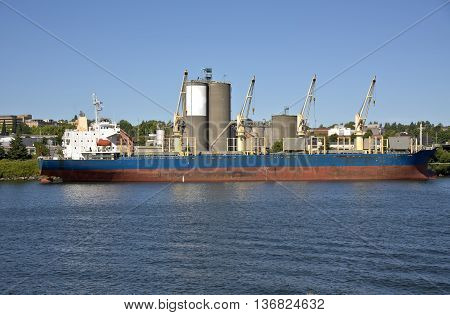 Cargo tanker ship waiting for a grain elevator in Portland Oregon.