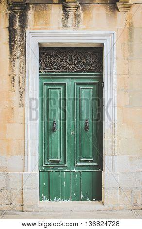 Green Wooden Doors with Black Metal Knockers Malta