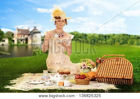 vintage woman picnic by lake drinking tea