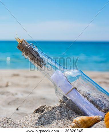 message in a bottle on an empty beach