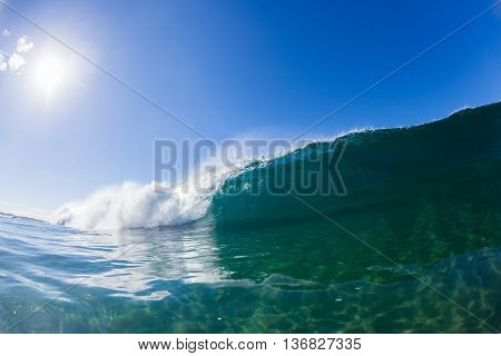 Wave inside hollow crashing blue water swimming photo.