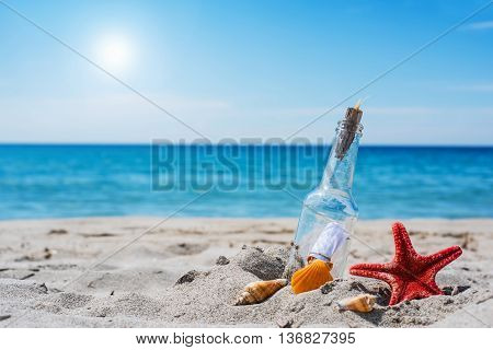 bottle with message on a tropical beach