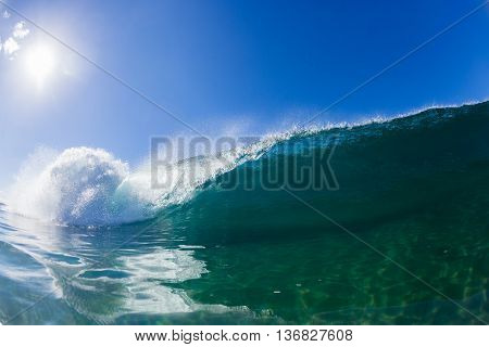 Wave inside hollow crashing blue ocean water swimming photo