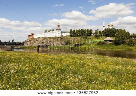 Verkhotursky Kremlin and suspension bridge over the River Tour. Verkhoturye. Russia