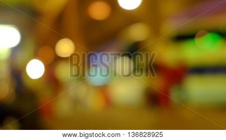 Abstract blurred image of people in night exhibition. warm light tone.