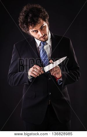 Mad Businessman Holding A Kitchen Knife