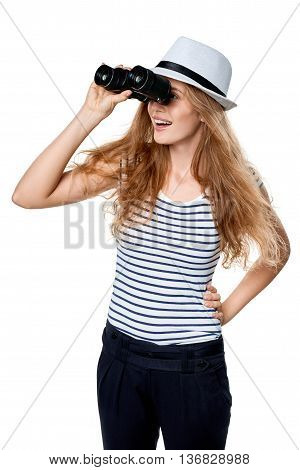 Young beautiful teen female in striped tee and white straw fedora hat looking through binoculars away, over white background