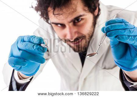 Handsome Dentist Operating