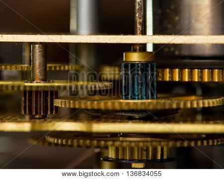 Vintage antique gold clockwork mechanism. Macro shot