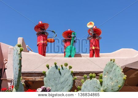 Fun models of Mexican musicians on a roof