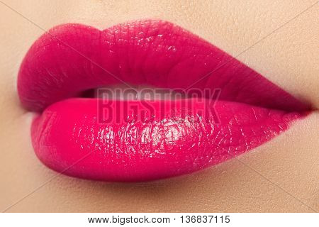Perfect smile. Beautiful full pink lips. Pink lipstick. Gloss lips. Make-up and cosmetics