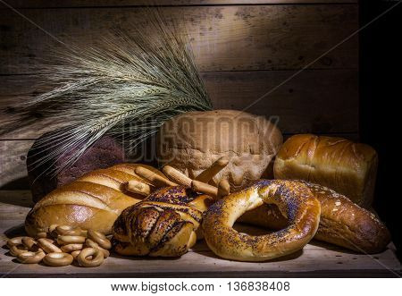 still life of bread bakery and ears of wheat