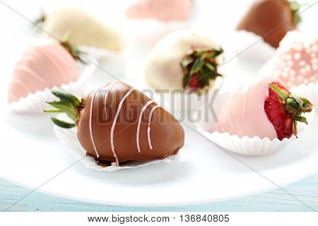 Strawberries Covered In Chocolate On A Blue Wooden Table