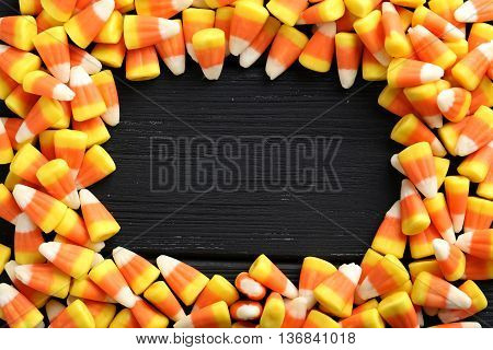 Halloween Candy Corns On Black Wooden Background