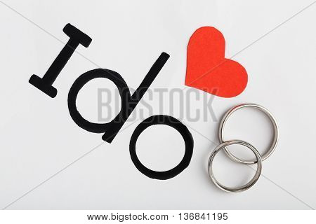 Silver Wedding Rings With Red Heart And Words I Do