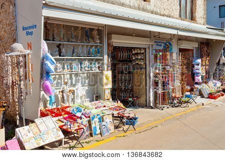 MEDJUGORJE, BOSNIA AND HERZEGOVINA - JULY 20, 2014: Shop selling religious articles Blessed Virgin Mary related is appeared to six children in June 1981, on July  20, 2014 in Medjugorje.