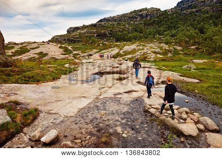 Unidentified group of tourists on hiking trail to Preikestolen (Pulpit Rock) a famous tourist attraction, on July 12, 2015 Forsand, Norway.