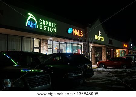 JOLIET, ILLINOIS / UNITED STATES - NOVEMBER 23, 2015: The Crossroads Plaza, during the night, in Joliet, Illinois.