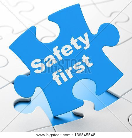 Security concept: Safety First on Blue puzzle pieces background, 3D rendering