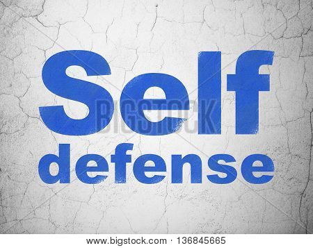 Security concept: Blue Self Defense on textured concrete wall background