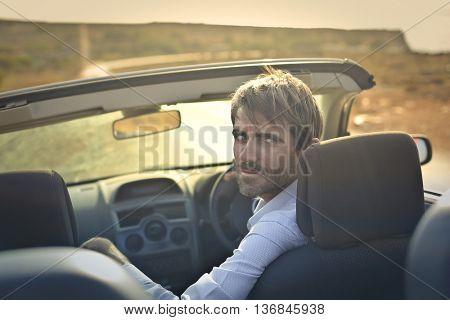 Man driving a sporty car