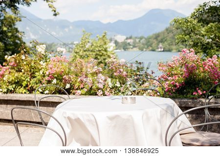 romantic table on beatiful terrace on island in lake Bled