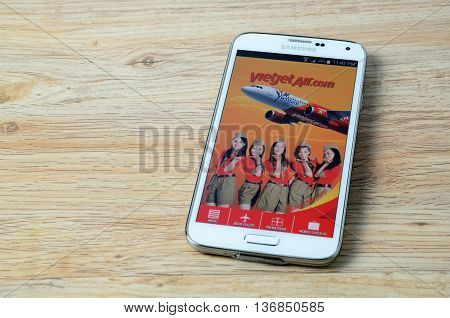 KOTA KINABALU MALAYSIA - JULY 1 2016: Vietjet Air on mobile app the app helps managing travel plans make bookings check-in and choose seat anytime anywhere.