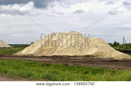 Hill of the mined sand piled in a sand quarry