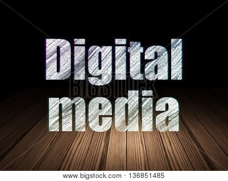 Marketing concept: Glowing text Digital Media in grunge dark room with Wooden Floor, black background