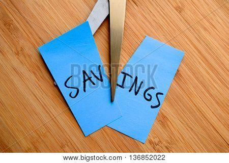 saving money concept - sticky note cut in half