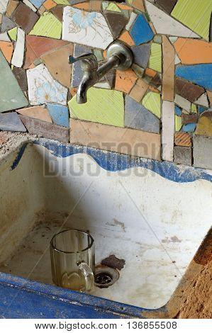 Sink ceramic tile mosaic kitchen equipment home interior.