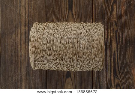 Roll of a twine jute on the wooden table