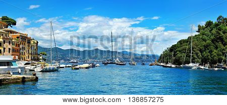 Panoramic view from small bay Portofino full of yachts and boats on Ligurian sea northern Italy.