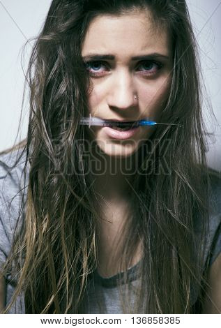 problem depressioned teenage with messed hair and sad face, junky with syringe