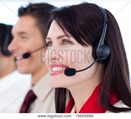 Young customer service agents with headset on in a call center
