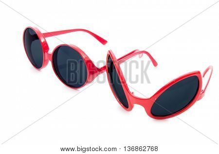 Red sunglasses isolated on white