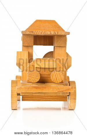 Hand made wooden toy car over white background