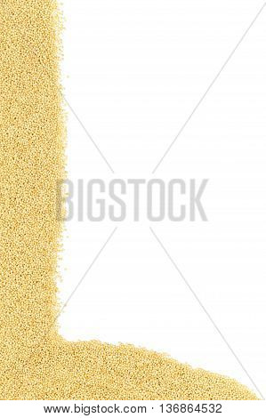 Raw uncooked amaranth seeds border on white background with copy space