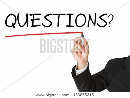Businessman in suit drawing the word 'questions' on whiteboard isolated on white background