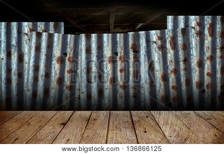 Wooden floor with the backdrop of rusty corrugated iron sheets in slum