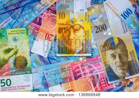 Business background made of swiss franc banknotes